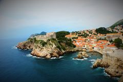 Dubrovnik coast with rocks and wall royalty free stock photography