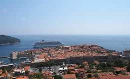 Dubrovnik, Croatia. JULY 16: The Costa Favolosa cruise ship passes very close to the old town walls, in  on July 16, 2011 Royalty Free Stock Photo