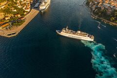 Free Dubrovnik, Croatia - Aug 22, 2020: Aerial Drone Shot Of Jadrolinija Ferry Near Dubrovnikk Bridge In Sunset Stock Photo - 212907720