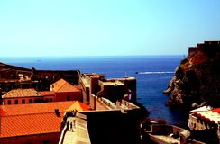 Dubrovnik Croatia. Coming upper and upper it is nice to enjoy magnificent view of old city of Dubrovnik. People and other objects look very small from the wall stock photo