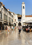 DUBROVNIK. CROATIA. DUBROVNIK - JUNE 20, 2017: Tourists visiting the sights on the main pedestrian street of the historic city center. It is paved with limestone Royalty Free Stock Photography