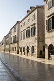 Dubrovnik, Croatia, July 20 2017: Empty pedestrian street with old houses in Dubvronik. Dubrovnik, Croatia, July 20 2017: Empty pedestrian street with old houses Royalty Free Stock Image