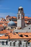 Dubrovnik, Croatia, June 2015. Tiled roofs of the old city. View of the bell tower of the cathedral. royalty free stock images
