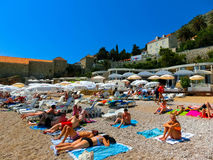 Dubrovnik, Croatia - June 07, 2015: Tourists on beach Banje Stock Images