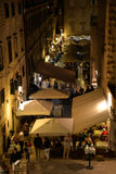 Dubrovnik, Croatia, night view of a busy old city narrow lane Stock Photos