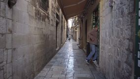 Dubrovnik, Croatia - November 23, 2018: Handheld tracking shot a narrow alleyway in old city. Dubrovnik, Croatia - November 23, 2018: Handheld tracking shot a stock video