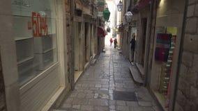 Dubrovnik, Croatia - November 23, 2018: Handheld tracking shot a narrow alleyway in old city. Dubrovnik, Croatia - November 23, 2018: Handheld tracking shot a stock footage