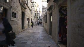 Dubrovnik, Croatia - November 23, 2018: Handheld tracking shot a narrow alleyway in old city. Dubrovnik, Croatia - November 23, 2018: Handheld tracking shot a stock video footage
