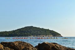 Dubrovnik / Croatia - September 09 2014: Group of people are kayaking in the bay of Dubrovnik. royalty free stock images