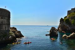 Dubrovnik / Croatia - September 09 2014: Group of people are kayaking in the bay of Dubrovnik. royalty free stock image