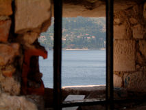 Dubrovnik fortress. Looking through the bars of the window of fortress in Dubrovnik, Croatia, Europe, Adriatic sea Royalty Free Stock Images