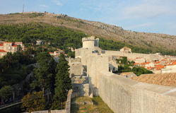 Dubrovnik Fortress Wall of Old Town. Fortress Wall of old town Dubrovnik in Croatia, shot in the warm light of the sunset Stock Photo