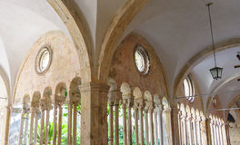 Dubrovnik Franciscan monastery cloister colonnades. DUBROVNIK, CROATIA - SEPTEMBER 1, 2009: Double column colonnades with individualized capitals along the royalty free stock photos