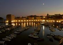 Dubrovnik harbor by night stock photos