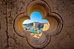 Dubrovnik harbor view from Ploce gate through stone carved detail. Dalamtia region of Croatia stock photo