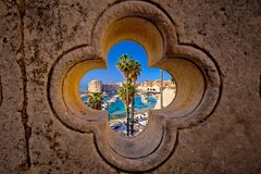 Dubrovnik harbor view from Ploce gate through stone carved detai. L, Dalamtia region of Croatia Royalty Free Stock Images
