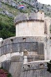 Dubrovnik Minceta tower, flag and mountains Stock Photos