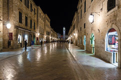 Dubrovnik at night. DUBROVNIK, CROATIA - MAY 16, 2013: People walking down the main street in the old town of Dubrovnik at night. Pedestrian zone in an old Royalty Free Stock Photo