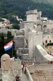 Dubrovnik old city wall, Croatia flag people Royalty Free Stock Photography
