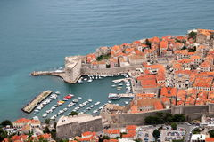 Dubrovnik. Old harbour of the city of Dubrovnik, a popular tourist destination, and a filming location of a popular TV drama, in Croatia Stock Photography