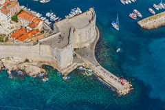 Dubrovnik old town. Aerial helicopter shoot of Dubrovnik old town. Walls detail -St. John Fortress with entrance to the old city port Stock Photo