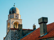 Dubrovnik Old Town, Croatia. Tiled roofs of houses. Church in th Stock Image