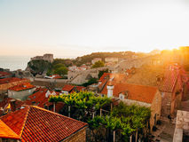 Dubrovnik Old Town, Croatia. Tiled roofs of houses. Church in th Stock Photos