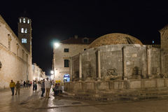 Dubrovnik, Onofrio's fountain. DUBROVNIK, CROATIA - MAY 16, 2013: People are visiting Onofrio's Fountain in Dubrovnik old city at Croatia. Onofrio's fountain is Royalty Free Stock Photo