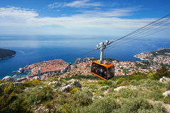 Dubrovnik panorama with cable car moving down. Dubrovnik panorama from mount Srd with cable car moving down royalty free stock photography
