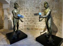 Dubrovnik`s Clock Tower bell striking bronze figure stock images