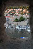 Dubrovnik. Small houses with red roofes and marina in Dubrovnik Stock Photo