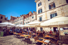 Dubrovnik street cafes at main square Stock Photos
