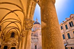 Dubrovnik street historic architecture and arches view. The Assumption Cathedral, Dalmatia region of Croatia stock image