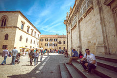 Dubrovnik street life, Croatia. DUBROVNIK, CROATIA - MAY 03, 2015: Scene of the main street and other narrow streets, with locals and tourists, in Dubrovnik Stock Images