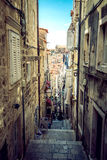 Dubrovnik street life, Croatia. DUBROVNIK, CROATIA - MAY 03, 2015: Scene of the main street and other narrow streets, with locals and tourists, in Dubrovnik Stock Photography
