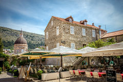 Dubrovnik street life, Croatia. DUBROVNIK, CROATIA - MAY 03, 2015: Scene of the main street and other narrow streets, with locals and tourists, in Dubrovnik Royalty Free Stock Photos