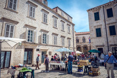 Dubrovnik street life, Croatia. DUBROVNIK, CROATIA - MAY 03, 2015: Scene of the main street and other narrow streets, with locals and tourists, in Dubrovnik Stock Photos