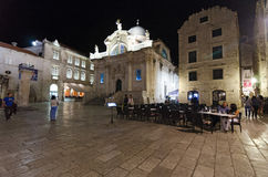 Dubrovnik street at night. DUBROVNIK, CROATIA - MAY 16, 2013: tables of a street restaurant in the old town of Dubrovnik. On 16 May 2013 in Dubrovnik, Croatia Stock Photo