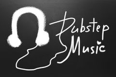 Dubstep music text and Drawn earphones on blackboard royalty free stock photos