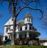 Dubuque Queen Anne. This is a Spring picture of a large old house located in Dubuque, Iowa.  The house built in the 1890.s is an example of Queen Anne Royalty Free Stock Image