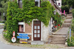 Dubuy in the Ardennes. Overgrown corner home in medieval Durbuy, the smallest city in Belgium royalty free stock photo