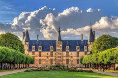 Ducal Palace of Nevers with clouds. The 15th century historical monument Ducal Palace of Nevers. Palais ducal de Nevers is the first of the river Loire's Stock Image