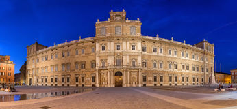 Ducal palace on Piazza Roma in Modena. Panoramic view on Ducal palace on Piazza Roma in Modena in the evening, Emilia-Romagna, Italy royalty free stock photography