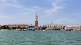 Ducal Palace and St. Mark`s Bell Tower over water in Venice, Ita stock photos
