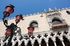 The Ducal Palace, Venice, Italy. The Ducal Palace of Venice and a typical lamp with pigeons Stock Image