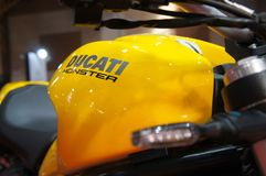 DUCATI emblem and logos at the Ducati motorcycle body. KUALA LUMPUR, MALAYSIA -MARCH 24, 2018: DUCATI emblem and logos at the Ducati motorcycle body. DUCATI is stock photos