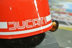 DUCATI logos at the motorcycle body. SERDANG, MALAYSIA -JULY 29, 2017: DUCATI logos at the motorcycle body. DUCATI is one of the famous motorcycle manufactures royalty free stock photo