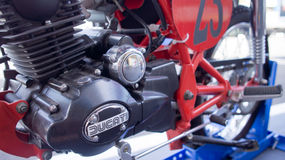 Ducati motorcycle engine. An engine view of a classic Ducati motorcycle on a stand on display outside a cafe restaurant. Photo taken on December 23rd, 2014 Royalty Free Stock Photography
