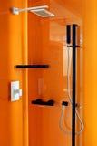 Ducha anaranjada Foto de archivo libre de regalías