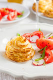 Duchesse potatoes with mushrooms. Baked mashed potatoes with wild mushrooms and vegetables on a white background stock photo